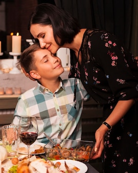 Medium shot mother and son at dinner table