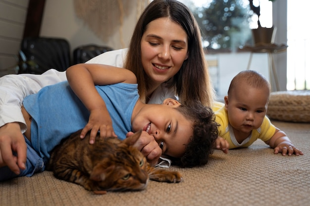 Medium shot mother with kids and cat