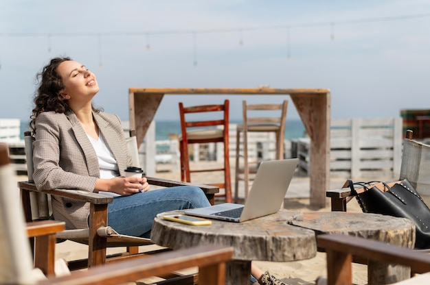 Medium shot nomad with laptop