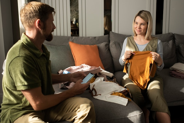 Medium shot parents to be with baby items