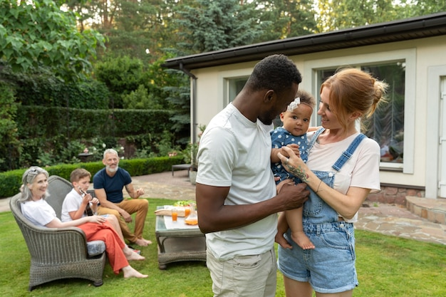 Medium shot parents holding baby