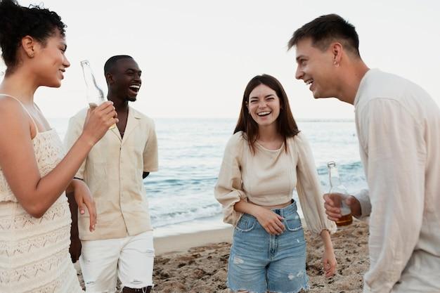 Medium shot people having fun at beach