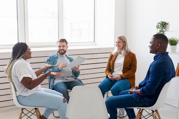 Medium shot people sitting indoors