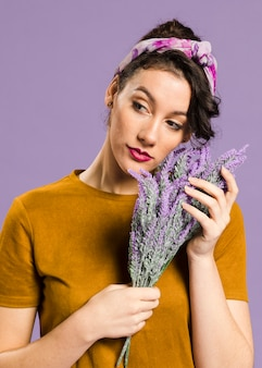 Medium shot portrait of woman and lavender