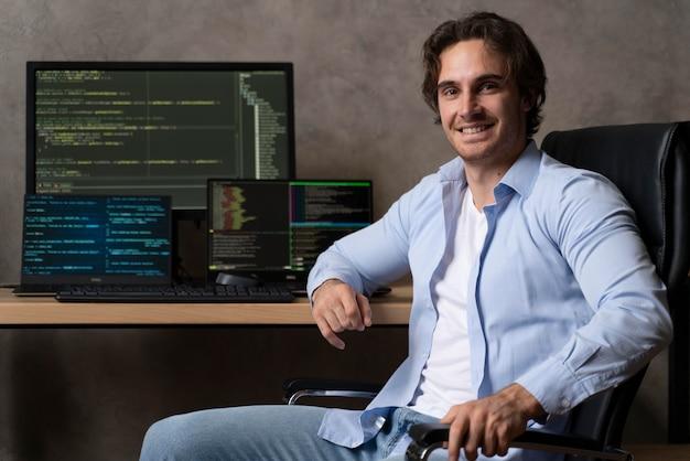 Medium shot programmer sitting on chair