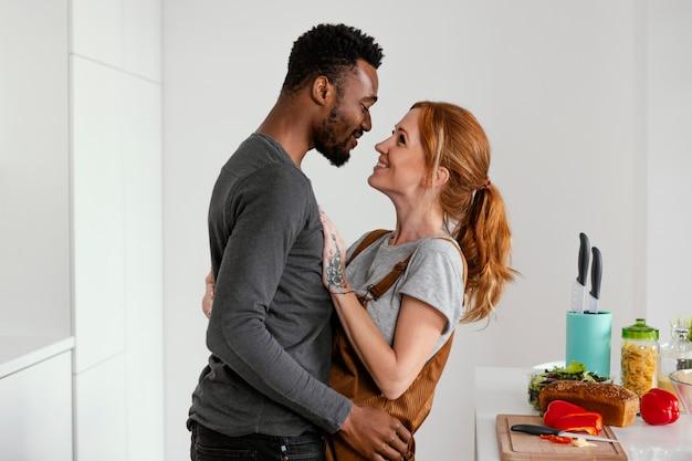 Medium shot romantic couple indoors