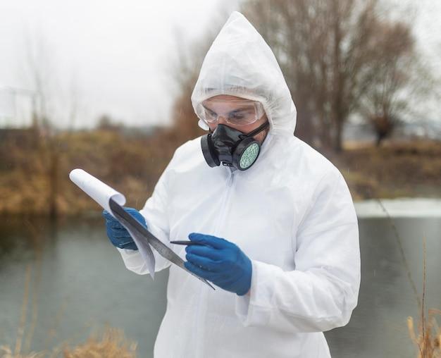 Medium shot scientist holding clipboard