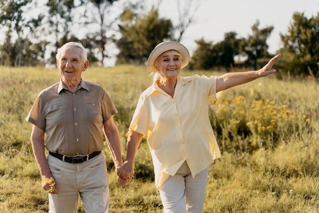 Medium shot senior couple holding hands
