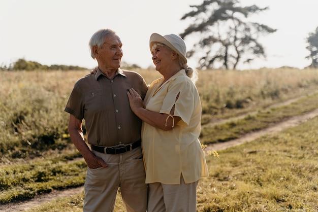 Medium shot senior couple outdoors
