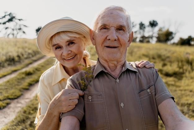 Medium shot senior couple posing