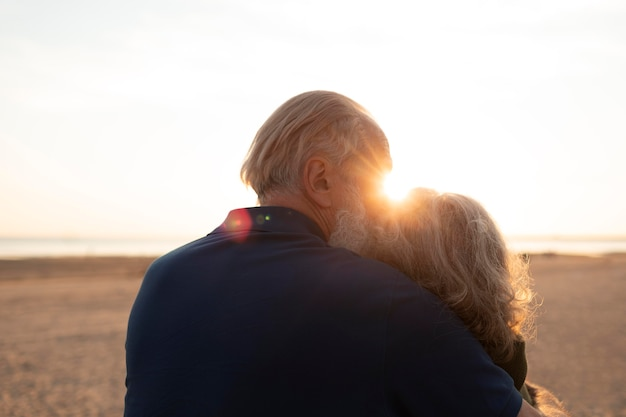Medium shot senior couple at sunset