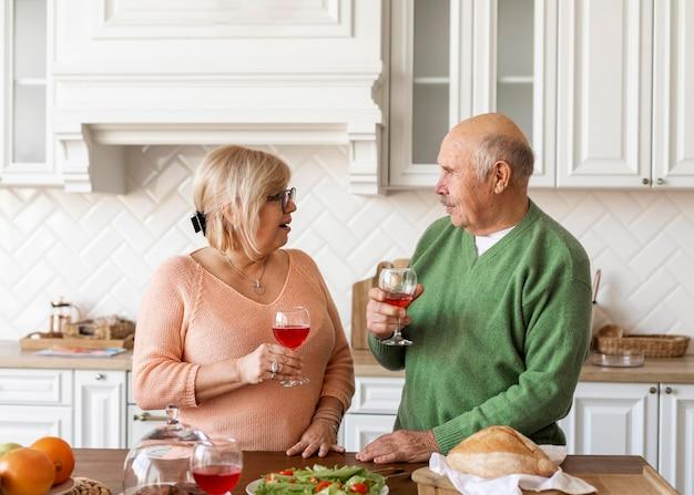 Medium shot senior couple with drinks