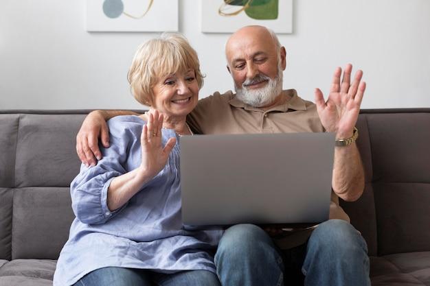Medium shot senior couple with laptop