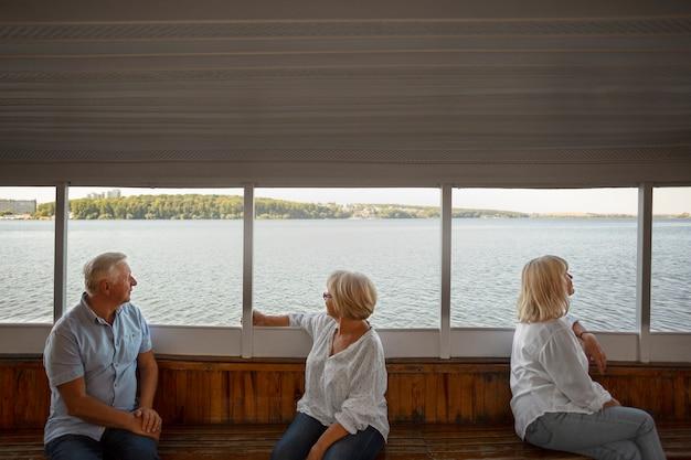 Medium shot senior friends on boat