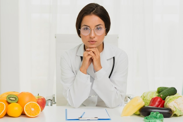 Medium shot serious nutritionist with glasses