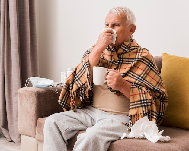 Medium shot sick man holding cup