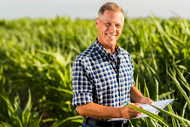 Medium shot smiley agronomist