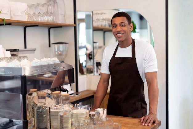 Medium shot smiley barista