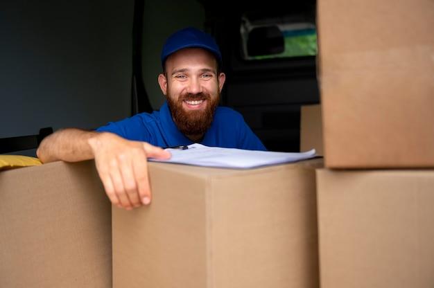 Medium shot smiley delivery man