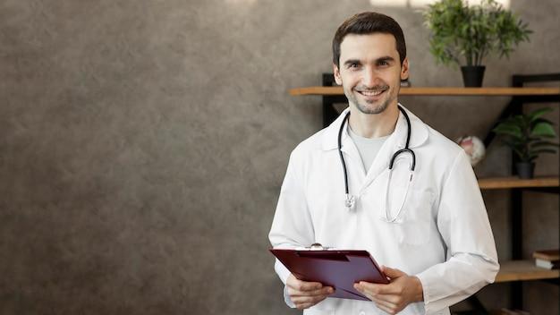 Medium shot smiley doctor with stethoscope