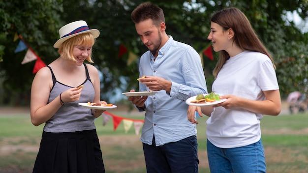 Medium shot smiley friends holding plates