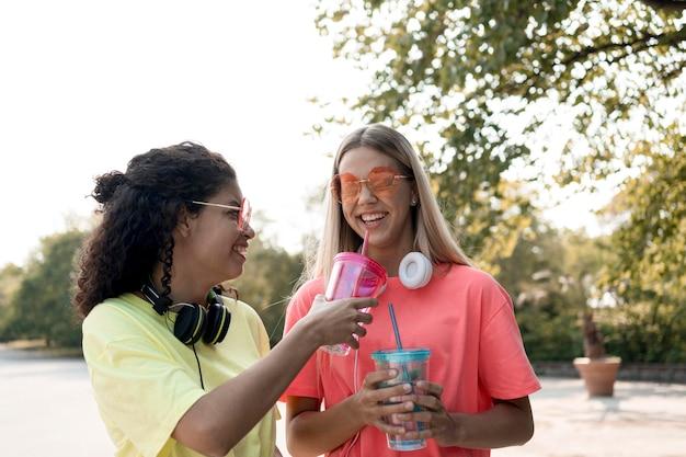 Medium shot smiley girls outdoors