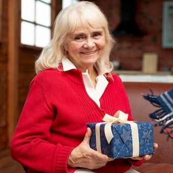 Medium shot smiley grandma with gift