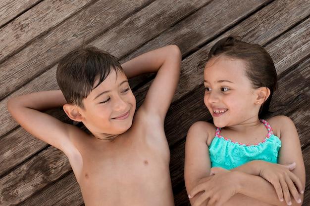 Medium shot smiley kids outdoors