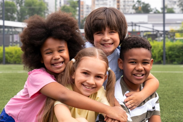 Medium shot smiley kids posing together