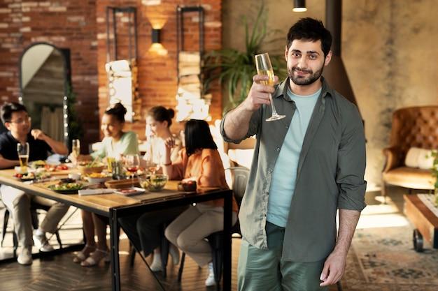 Medium shot smiley man holding glass