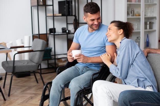 Medium shot smiley man in wheelchair