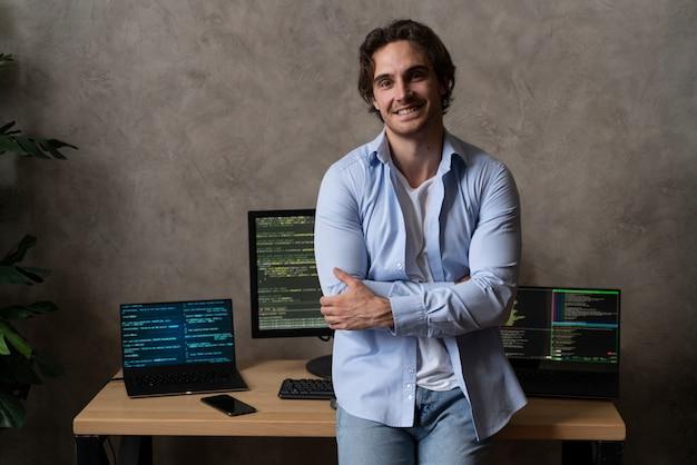 Medium shot smiley programmer indoors