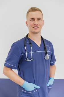 Medium shot smiley veterinarian posing with uniform