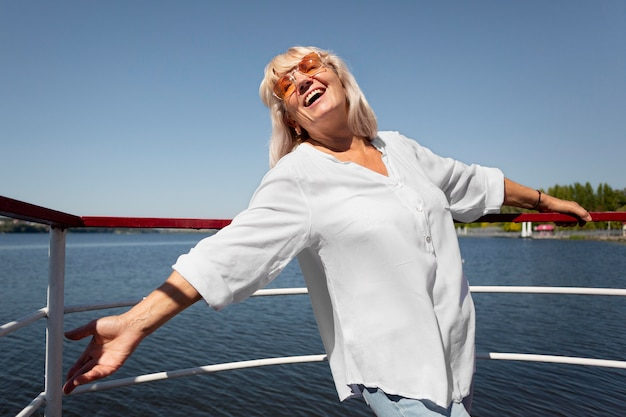 Medium shot smiley woman on boat