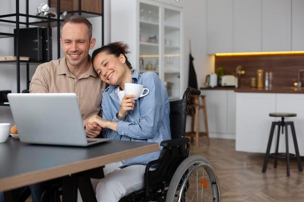 Medium shot smiley woman in wheelchair