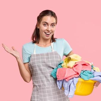 Medium shot smiley woman with apron