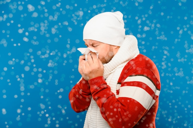 Medium shot of sneezing winter model