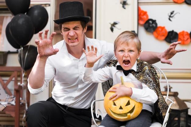 Medium shot spooky man and kid