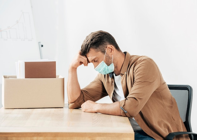 Medium shot stressed man at desk