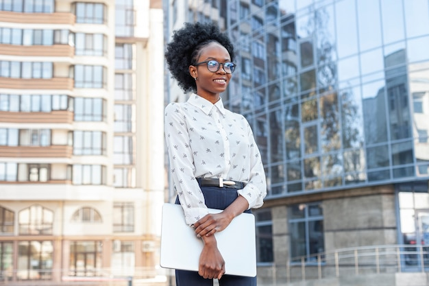 Medium shot stylish african woman in office clothes