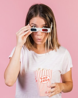 Medium shot surprised girl with popcorn