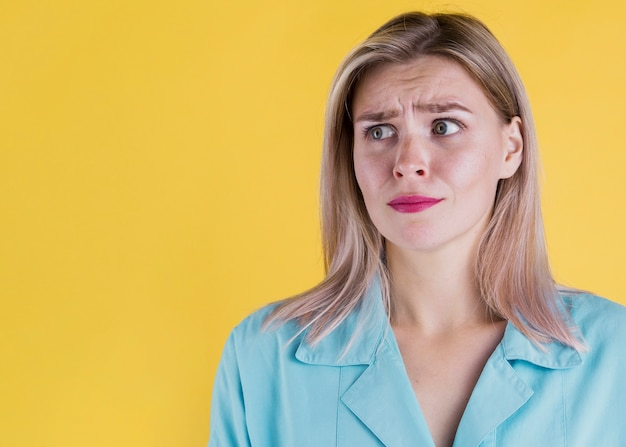 Medium shot of suspicious woman