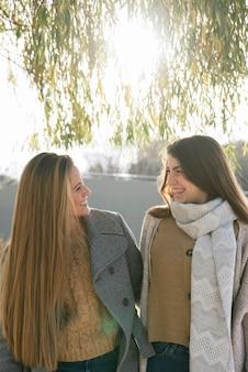 Medium shot of two women talking in the park