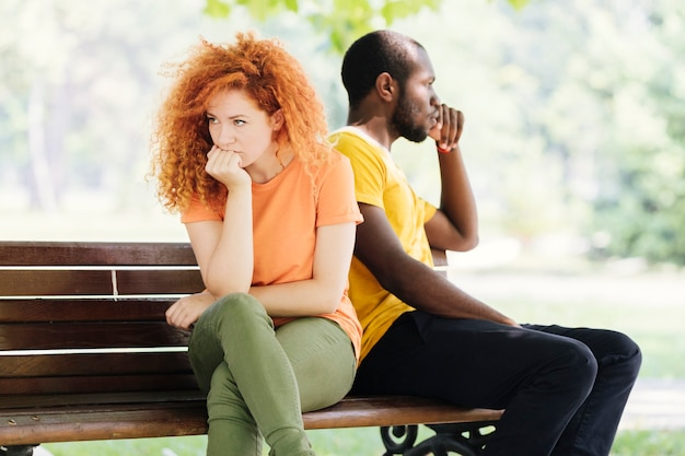 Medium shot of upset couple in the park