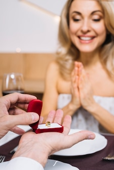 Medium shot of woman being proposed to