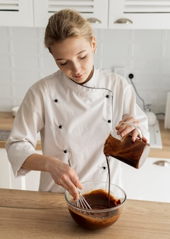 Medium shot woman cooking