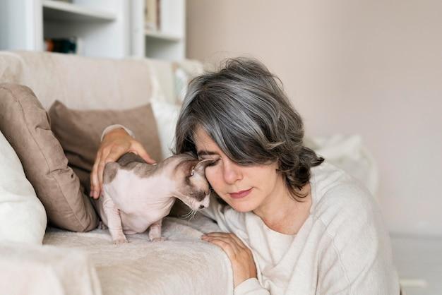 Medium shot woman and cute cat