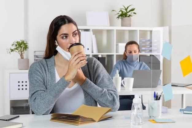 Medium shot woman drinking coffee