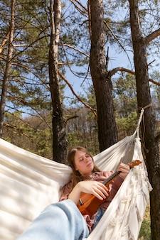 Medium shot woman in hammock