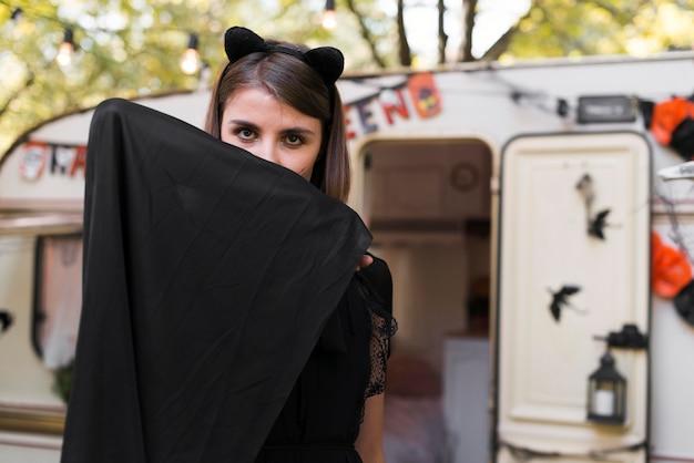 Medium shot woman hiding behind scarf